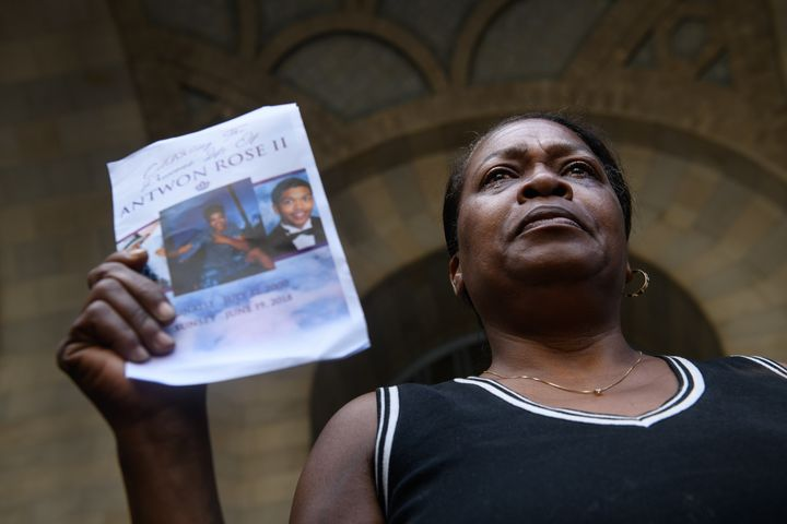Carmen Ashley, the great aunt of Antwon Rose Jr., cries as she holds the memorial card from Rose's funeral during a June 26 p