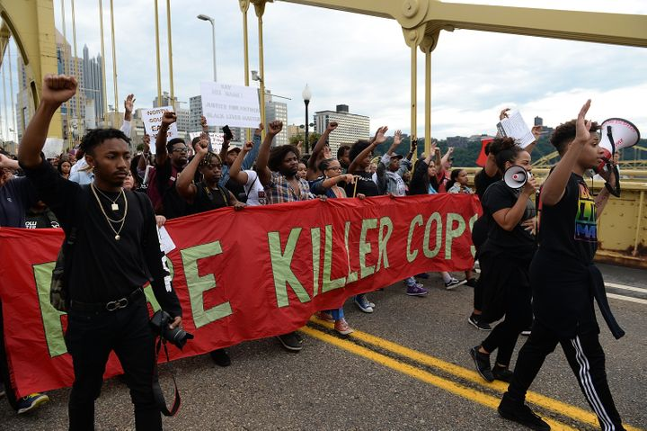 People marching over the Roberto Clemente Bridge in Pittsburgh on June 22, 2018. Demonstrators have protested the fatal shoot
