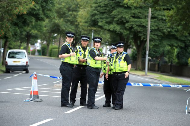 Police officers at the scene on Bingley Road.