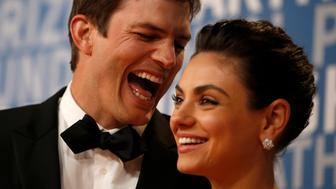 Actor Ashton Kutcher laughs with his wife actress Mila Kunis while posing for pictures on the red carpet for the 6th annual 2018 Breakthrough Prizes at Moffett Federal Airfield, Hangar One in Mountain View, Calif., on Sunday, Dec. 3, 2017. (Nhat V. Meyer/Bay Area News Group)(Digital First Media Group/Bay Area News via Getty Images)