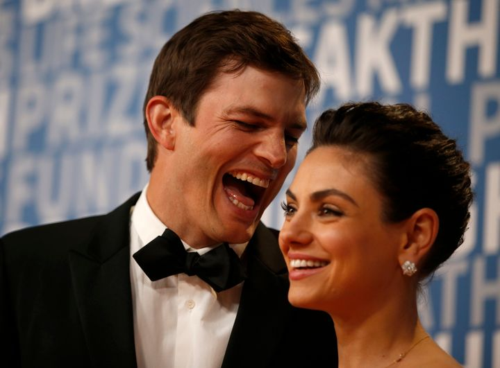 Ashton Kutcher and Mila Kunis while posing for pictures on the red carpet for the 6th annual 2018 Breakthrough Prizes.