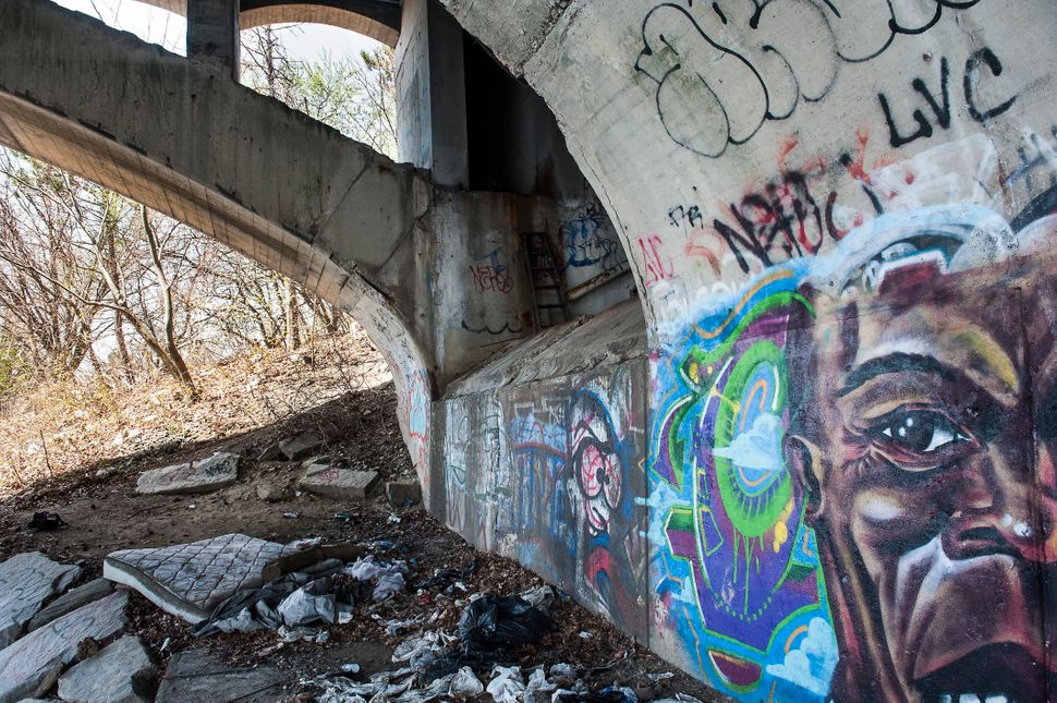 Abandoned homeless encampments dot the edges of the Merrimack River, which cuts through both Lawrence and Lowell.