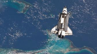 The space shuttle Atlantis is seen over the Bahamas prior to docking with the International Space Station with part of a Russian Progress spacecraft docked to the station in the foreground in this photo provided by NASA and taken July 10, 2011.    REUTERS/NASA/Handout    (UNITED STATES - Tags: SCI TECH TRANSPORT) FOR EDITORIAL USE ONLY. NOT FOR SALE FOR MARKETING OR ADVERTISING CAMPAIGNS. THIS IMAGE HAS BEEN SUPPLIED BY A THIRD PARTY. IT IS DISTRIBUTED, EXACTLY AS RECEIVED BY REUTERS, AS A SERVICE TO CLIENTS
