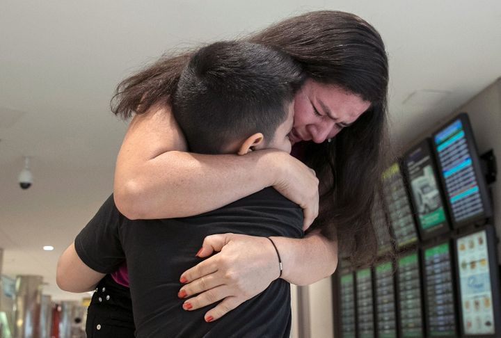 Seven-year-old Andy is reunited with his mother, Arely, at Baltimore-Washington International Airport on July 23. The mother