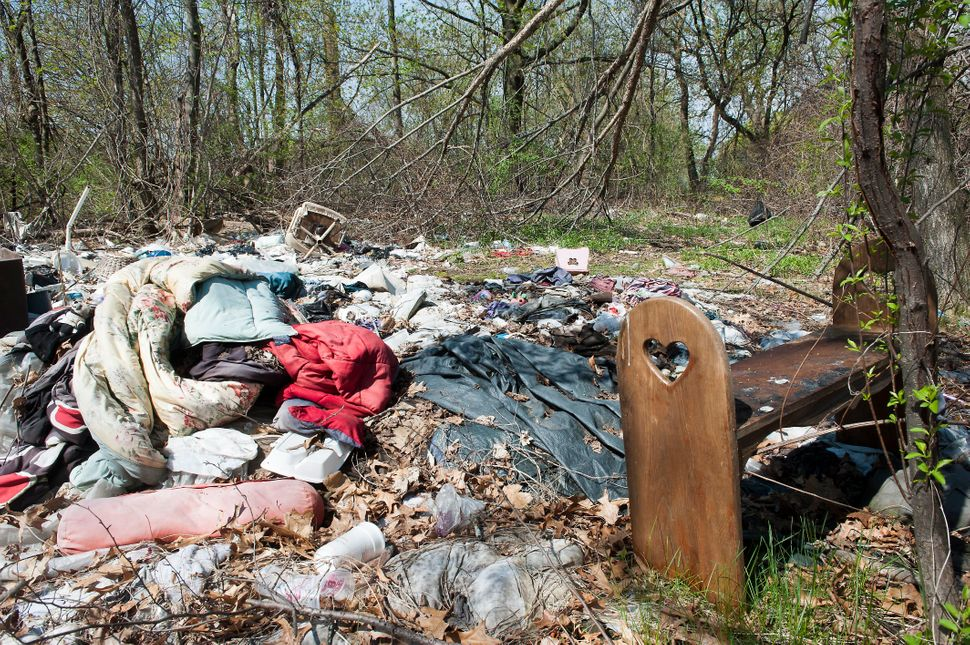 Abandoned clothing and sleeping bags near the Merrimack River are signs of Lawrence and Lowell's homeless population. In Lowe