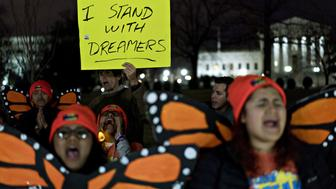 A demonstrator holds a sign reading 'I Stand With Dreamers' during a rally supporting the Deferred Action for Childhood Arrivals program (DACA), or the Dream Act, outside the U.S. Capitol building in Washington, D.C., U.S., on Sunday, Jan. 21, 2018. The House and Senate are back in session Sunday with a federal government shutdown in its second day amid a spending-bill impasse in Congress. The House is supposed to be on recess this week, but members stayed in Washington as negotiations continue. Photographer: Andrew Harrer/Bloomberg via Getty Images