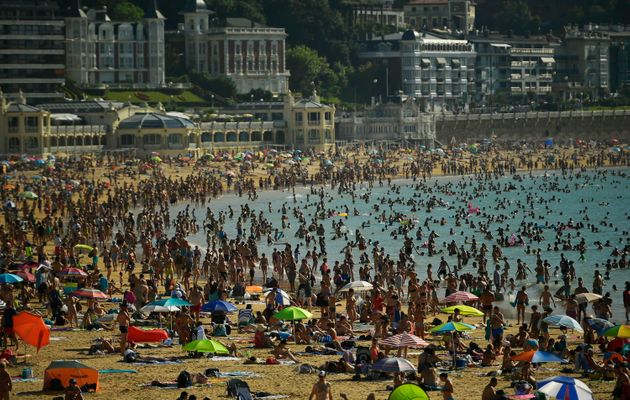 The hot weather is also affecting Spain, where people crowded beaches at La Concha in San