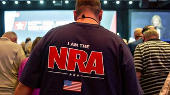 Members of the National Rifle Association (NRA) hold hands during an opening prayer at the NRA annual meeting in Dallas, Texas, U.S., on Saturday, May 5, 2018. President Donald Trump delivered a strong sign of support for the National Rifle Association at its annual meeting on Friday, as gun-rights advocates regroup in the wake of the mass shooting at a Florida high school. Photographer: Daniel Acker/Bloomberg via Getty Images