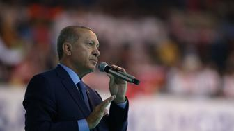 ANKARA, TURKEY - AUGUST 04: Turkish President Recep Tayyip Erdogan makes a speech during the ruling Justice and Development (AK) Party's Women Branch congress at the Ankara Sports Hall in Ankara, Turkey on August 04, 2018.  (Photo by Murat Kula/Anadolu Agency/Getty Images)