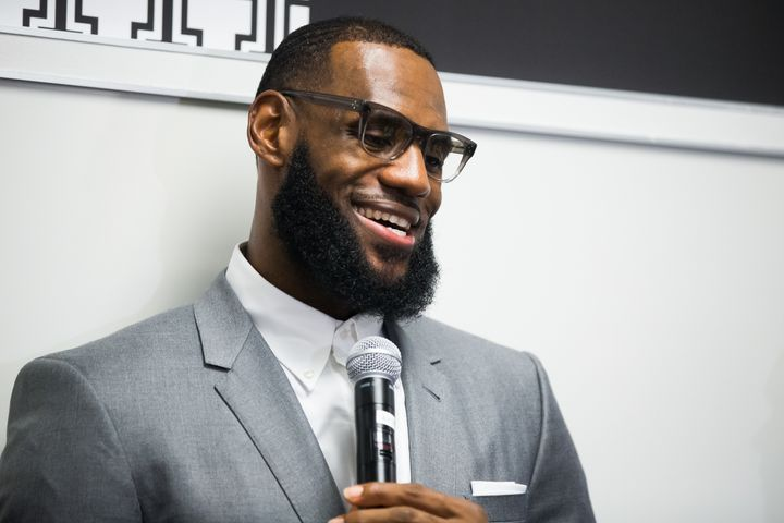 LeBron James speaks to the media during the grand opening of the I Promise School.