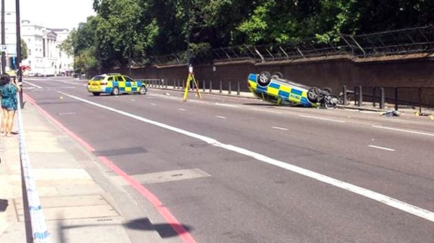 A police car overturned near Buckingham Palace on Saturday