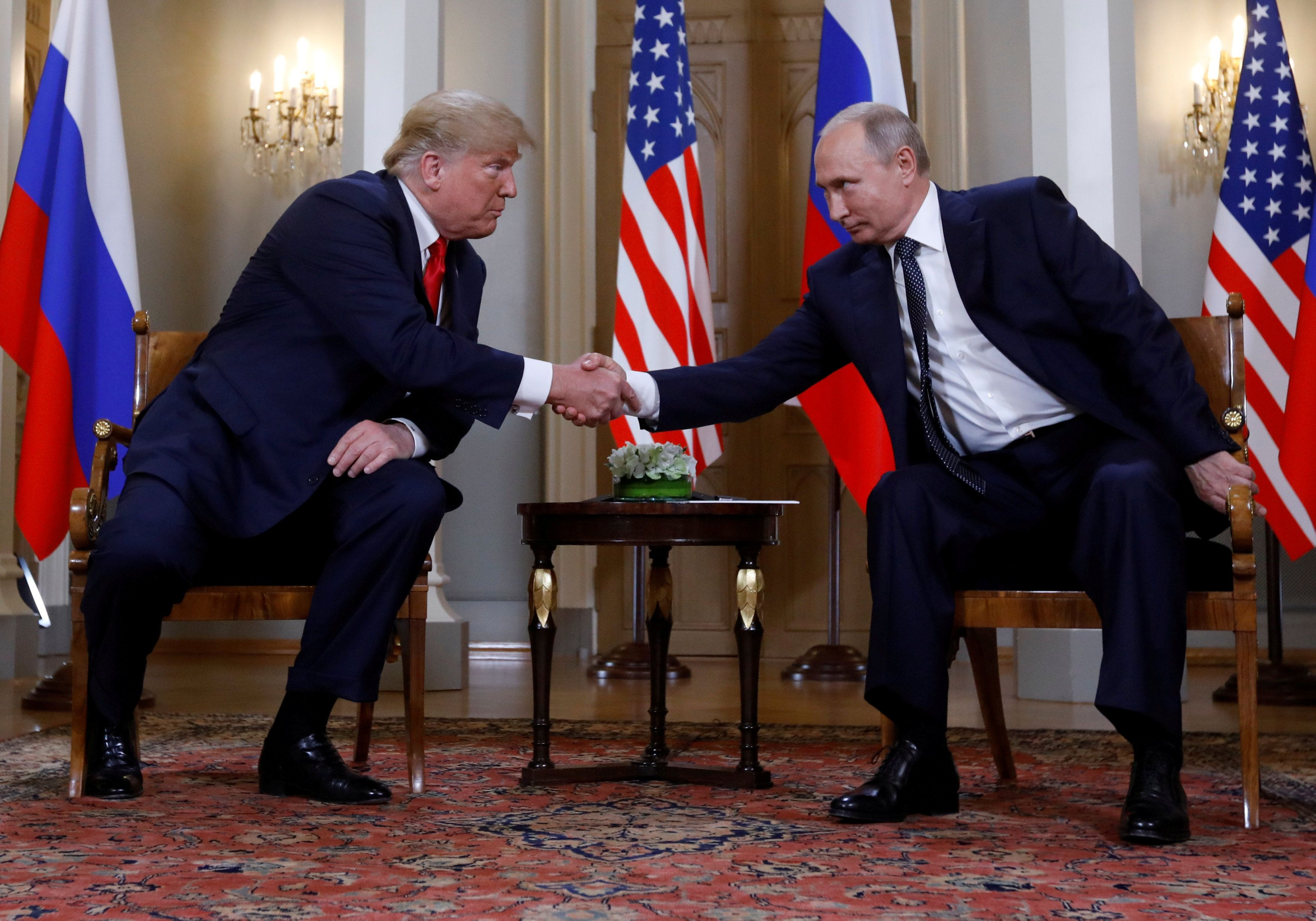 U.S. President Donald Trump and Russia's President Vladimir Putin shake hands as they meet in Helsinki, Finland July 16, 2018. REUTERS/Kevin Lamarque     TPX IMAGES OF THE DAY