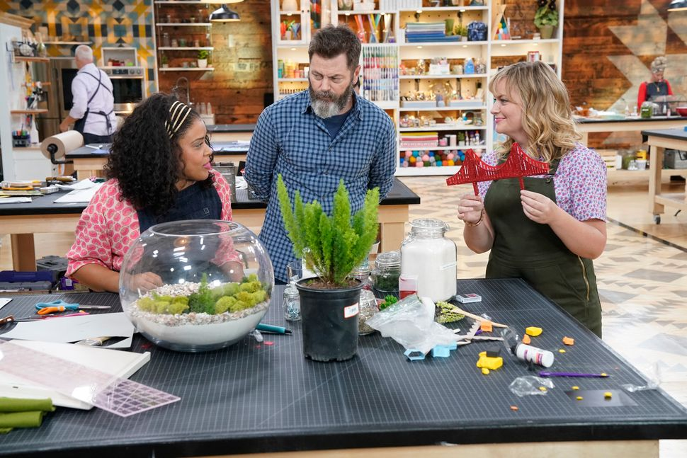 """Making It"" co-hosts Nick Offerman (center) and Amy Poehler (right) talk to competitor Amber Kemp-Gerstel (left) in the"