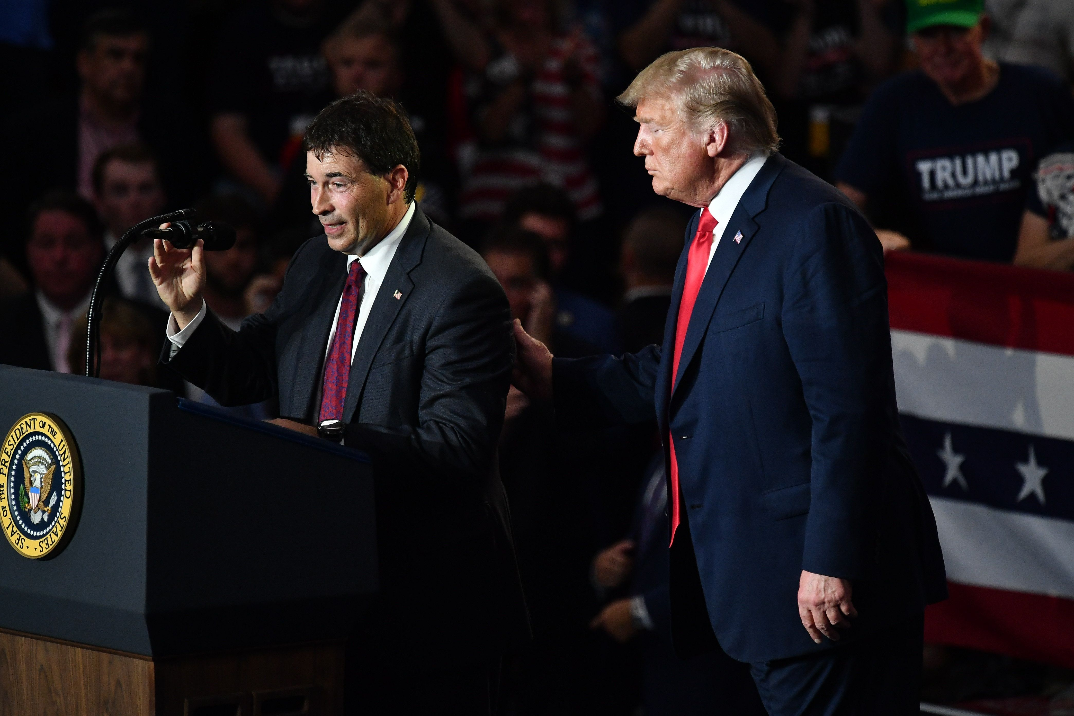 Republican House candidate Troy Balderson speaks next to President Donald Trump at a rally in Lewis Center Ohio on Saturday
