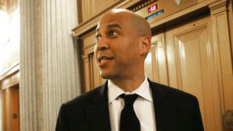 WASHINGTON, DC - FEBRUARY 13:  U.S. Sen. Corey Booker (D-NJ) is interviewed after walking out of the Senate following the vote confirming the nomination of Steve Mnuchin to become Treasury Secretary on February 13, 2017 in Washington, DC. Democratic senators complained of Mnuchin's role as a Wall Street insider ahead of the Senate vote on his nomination tonight.  (Photo by Mario Tama/Getty Images)