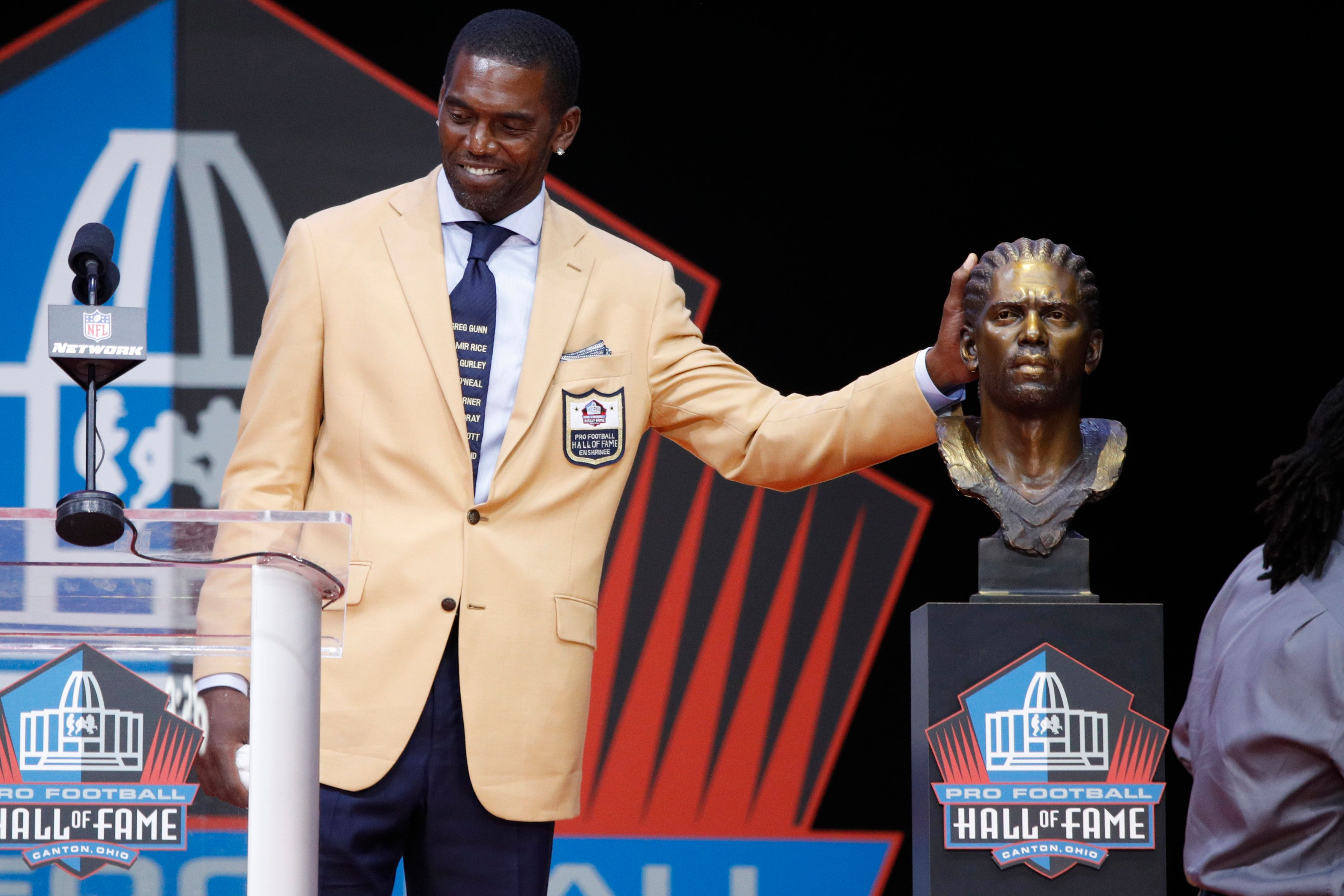CANTON, OH - AUGUST 04: Randy Moss reacts during the 2018 NFL Hall of Fame Enshrinement Ceremony at Tom Benson Hall of Fame Stadium on August 4, 2018 in Canton, Ohio. (Photo by Joe Robbins/Getty Images)