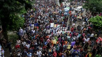 Bangladeshi students during clashes with the police during a student protest in Dhaka on August 5, 2018, following the deaths of two college students in a road accident. - Bangladesh Prime Minister Sheikh Hasina urged students on August 5 to go home as police fired tear gas during an eighth day of unprecedented protests over road safety which have paralysed parts of Dhaka. (Photo by Mamunur Rashid/NurPhoto via Getty Images)