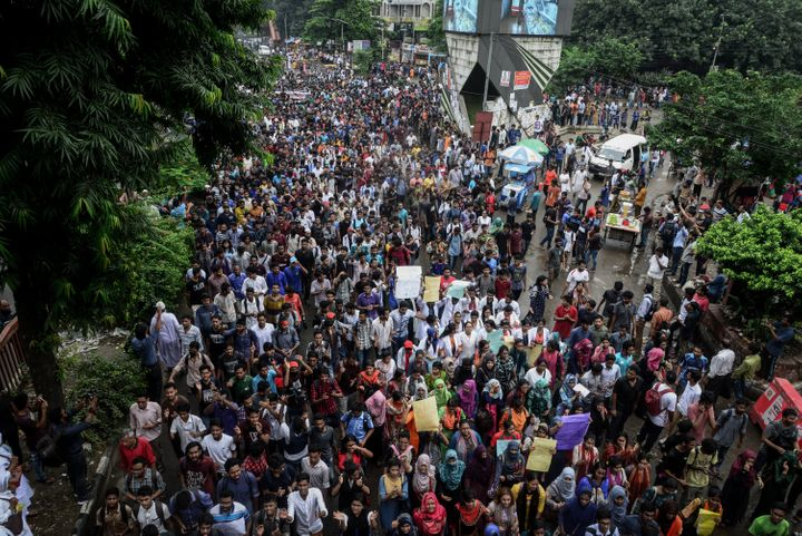 Bangladeshi students are seen during clashes with the police amid a student protest in Dhaka on Sunday.