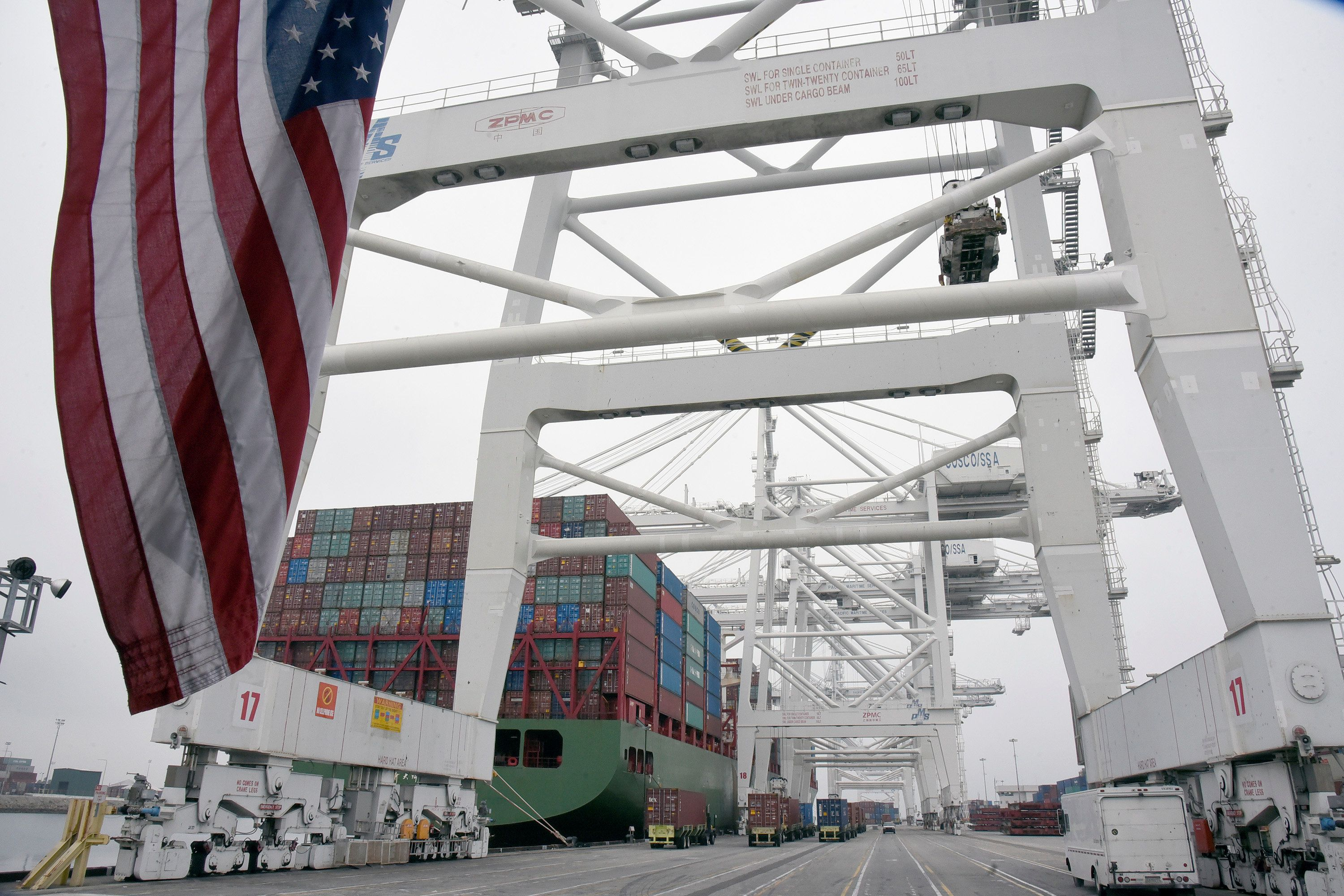 US shipping containers are being loaded onto a Chinese ship at Long Beach California in April