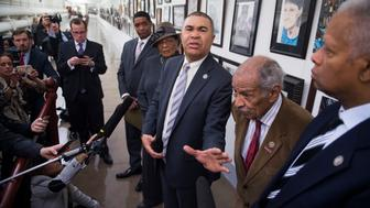 UNITED STATES - JANUARY 10: From left, Reps. Cedric Richmond, D-La., Alma Adams, D-N.C., William Lacy Clay, D-Mo., John Conyers, D-Mich., and Hank Johnson, D-Ga., speak in front of the painting by Missouri high school student David Pulphus after it was rehung, January 10, 2017. The painting was removed from the Congressional Art Competition display in Cannon tunnel by Rep. Duncan Hunter, R-Calif. (Photo By Tom Williams/CQ Roll Call)