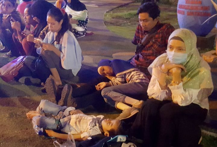 Residents spent the night on the town square in Mataram following the quake.
