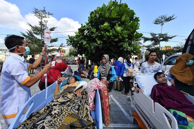 Séisme en Indonésie: au moins 91 morts, les secours à la recherche de