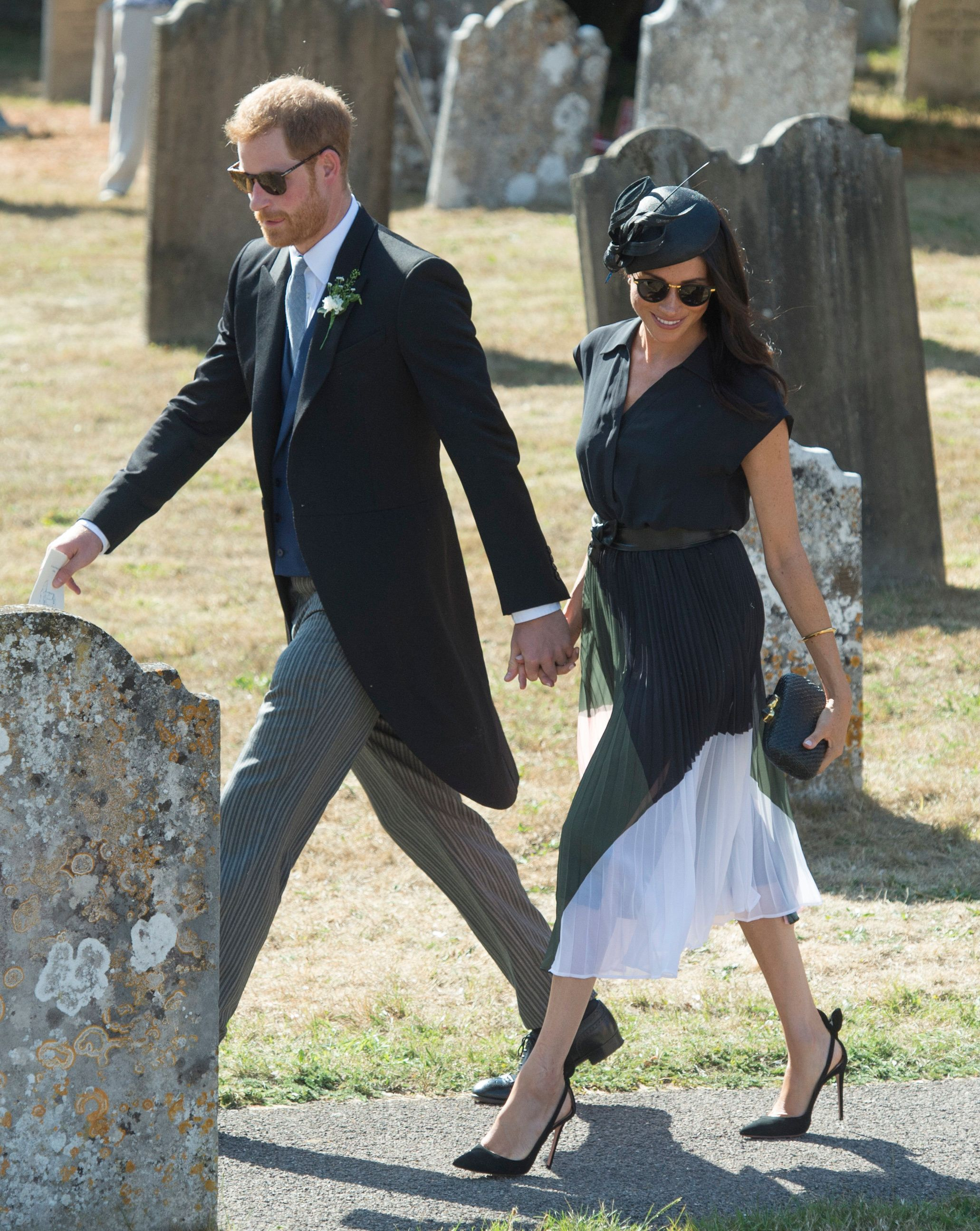 FRENSHAM, UNITED KINGDOM - AUGUST 04:  Prince Harry, Duke of Sussex and Meghan, Duchess of Sussex attend the wedding of Charlie Van Straubenzee and Daisy Jenks on August 4, 2018 in Frensham, United Kingdom. Prince Harry attended the same prep school as Charlie van Straubenzee and have been good friends ever since. (Photo by Antony Jones/Getty Images)