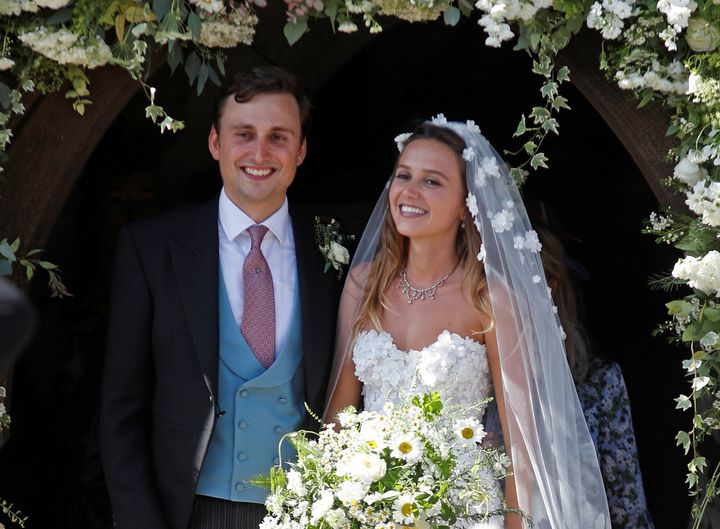 Daisy Jenks and Charlie Van Straubenzee emerge from the church after their wedding. <i></i>