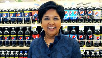 PepsiCo CEO Indra Nooyi poses for a portrait by products at the Tops SuperMarket in Batavia, New York, U.S. on June 3, 2013.  REUTERS/Don Heupel/File Photo