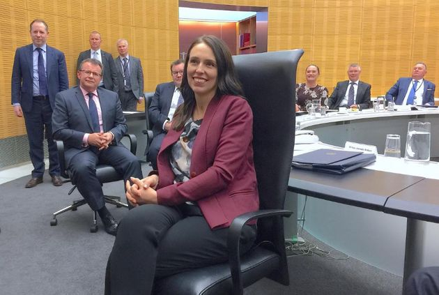 Jacinda Ardern poses for photographs during her first cabinet meeting since giving