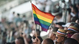 A spectator holds a rainbow flag during the opening ceremony of the 2018 Gay Games edition at the Jean Bouin Stadium in Paris on August 4, 2018. - French capital, Paris, hosts the Gay Games from August 4 to 12, 2018, bringing together participants from around the world for a week of sport and culture in a carnival atmosphere. Paris will welcome more than 10,000 participants from 90 countries around the world, including some where homosexuality is illegal or repressed. (Photo by Lucas Barioulet / AFP)        (Photo credit should read LUCAS BARIOULET/AFP/Getty Images)