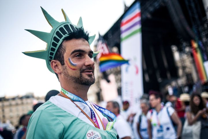 A man wears a cosplay of the Statue of Liberty as attends the inauguration of the sport village of the 2018 Gay Games' editio