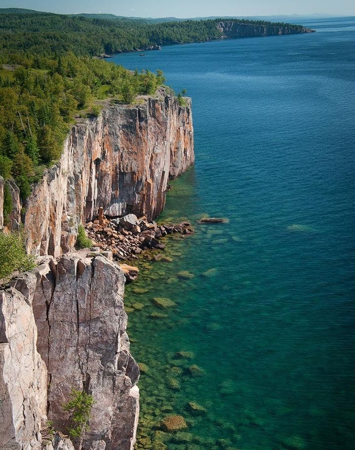 "<p>For a truly otherworldly experience, drive along the coast of the biggest freshwater lake in the world: <a rel=""nofollow"" href=""https://www.purewow.com/travel/photogenic-vacation-spots-us?utm_source=huffpo&utm_medium=syndication&utm_campaign=worldsbestisland"" target=""_blank"">Lake Superior</a>.</p>"