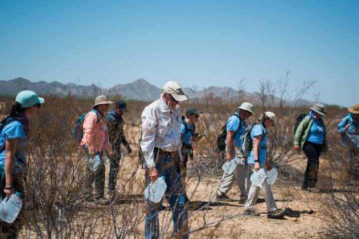 Clergy members and activists with the migrant aid group No More Deaths hike into the Cabeza Prieta National Wildlife Refuge o