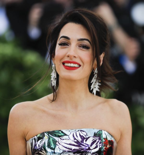 """Amal Clooney spoke about the challenges of breastfeeding twins during her cover interview for the May 2018 issue of <a href="""""""