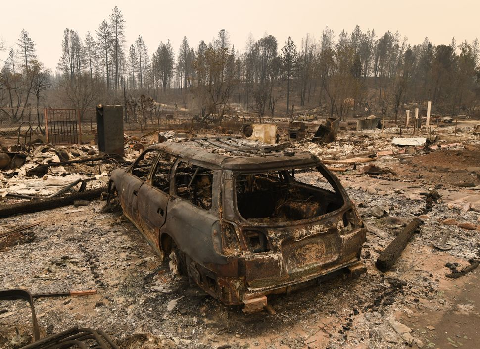 Burnt cars sit ruined in the Keswick neighborhood of Redding.