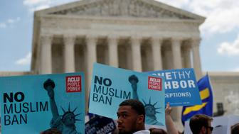Noah Toney (C) with the RABEN group protests with others after the U.S. Supreme Court upheld President Trump's travel ban outside of the U.S. Supreme Court in Washington, U.S., June 26, 2018. REUTERS/Leah Millis