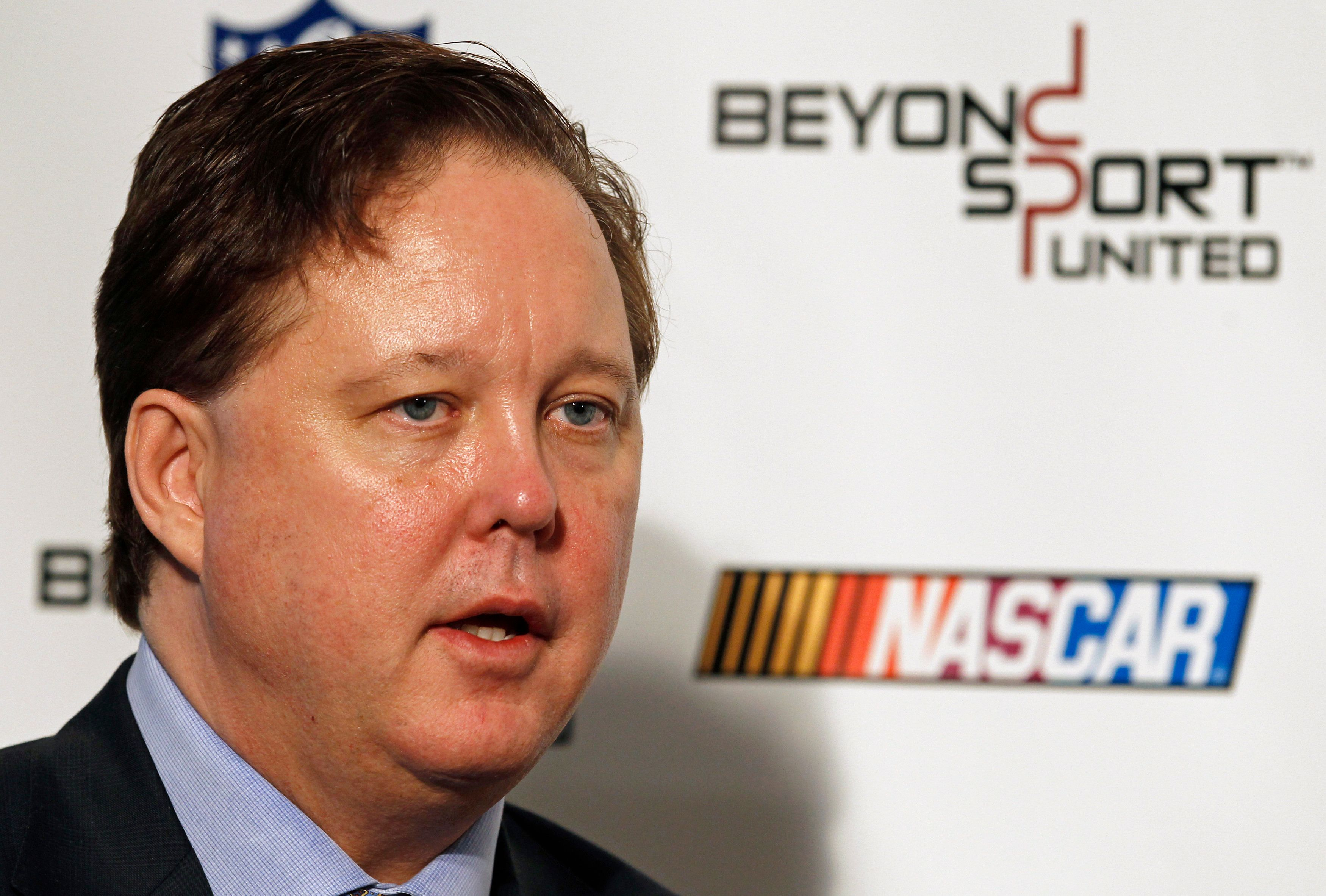 Brian France, chairman and chief executive of NASCAR, speaks during the Beyond Sport United summit at Yankee Stadium in New York November 13, 2012. REUTERS/Adam Hunger  (UNITED STATES - Tags: SPORT MOTORSPORT HEADSHOT)