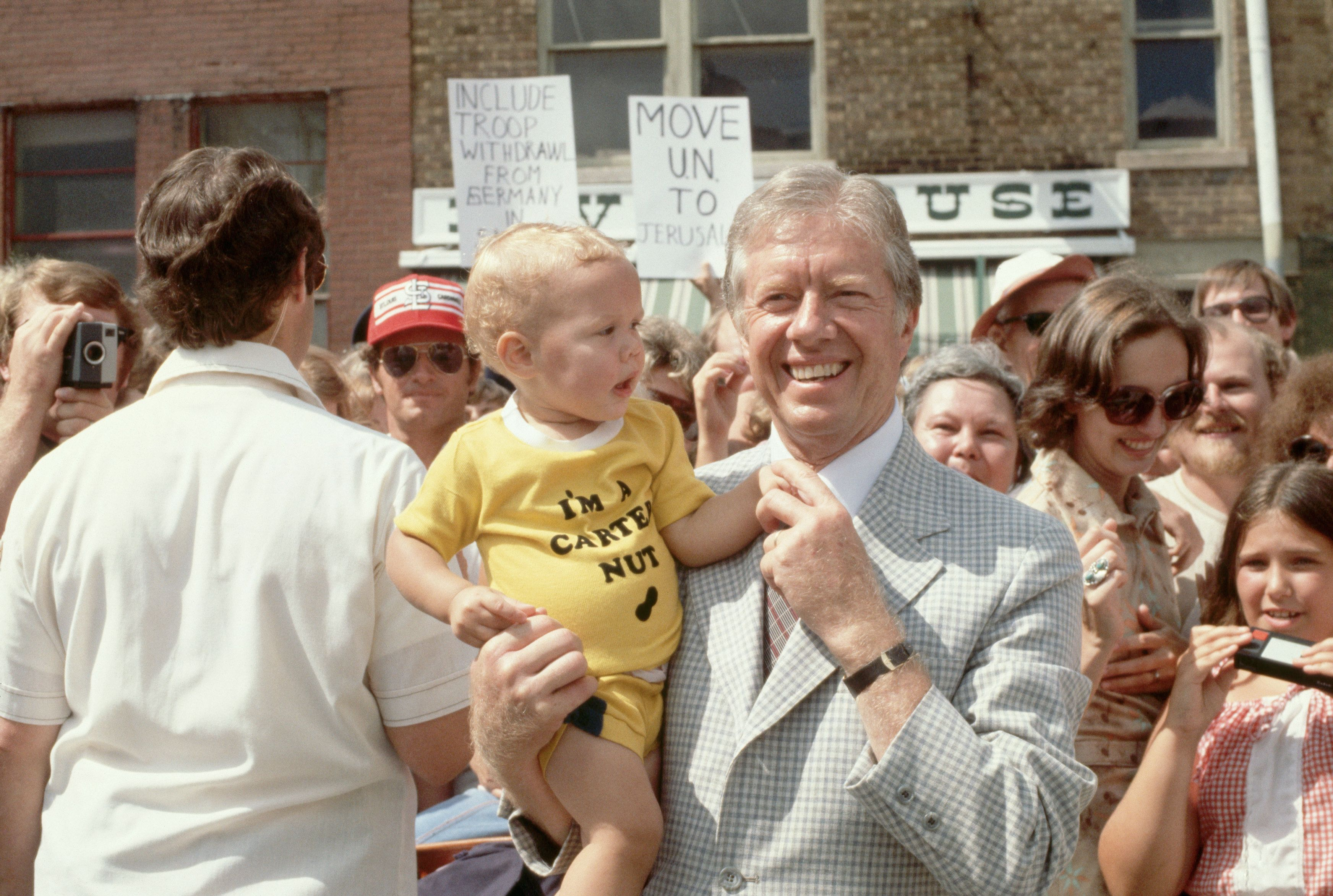President Jimmy Carter poses with a baby in Quincy, Illinois, in 1979. Last year, 9,753 boys and 598 girls were named Carter.