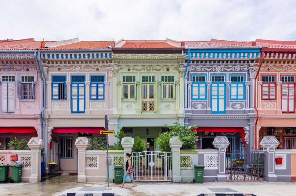 While traveling through Asia, Rachel seesPeranakan terrace houses (à la the ones pictured above on Joo Chiat Roa