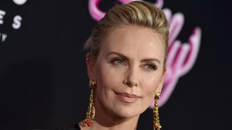 LOS ANGELES, CA - APRIL 18:  Actress Charlize Theron arrives at the Los Angeles premiere of Focus Features' 'Tully' at Regal LA Live Stadium 14 on April 18, 2018 in Los Angeles, California.  (Photo by Axelle/Bauer-Griffin/FilmMagic)