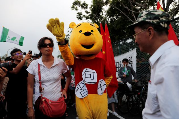 A student dressed in a Winnie The Pooh costume to mock Chinese President Xi Jinping at a demonstration...