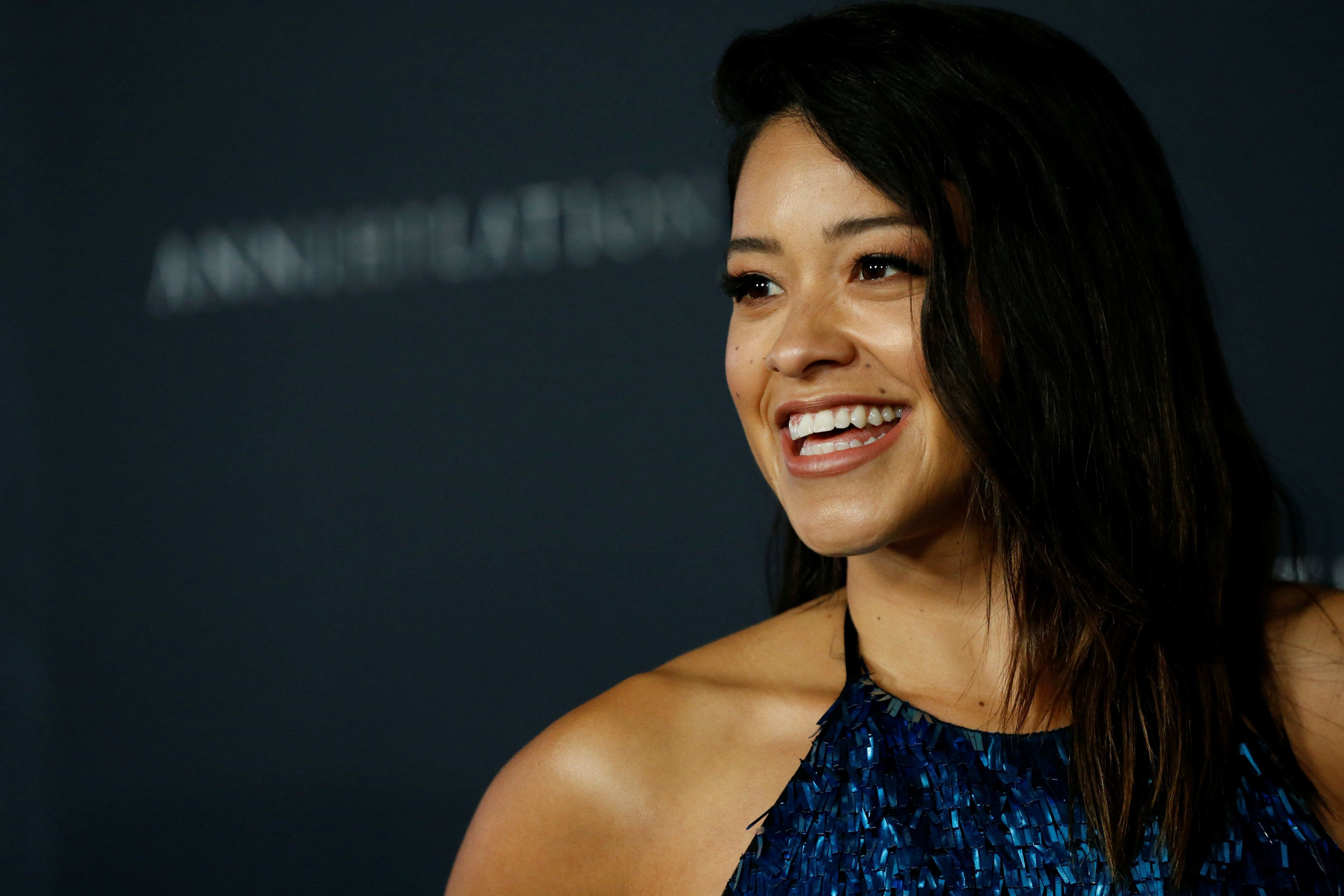 """Cast member Gina Rodriguez poses at the premiere for """"Annihilation"""" in Los Angeles, California, U.S., February 13, 2018. REUTERS/Mario Anzuoni"""