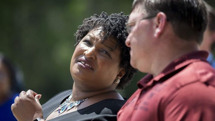 Georgia Democratic gubernatorial candidate Stacey Abrams, left, is more than $200,000 in debt, but says her indebtedness shou