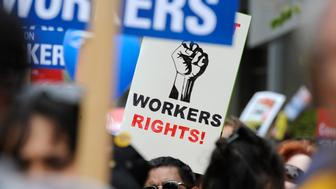 Participants carry signs during a march and rally by labor union supporters in Los Angeles March 26, 2011. REUTERS/Phil McCarten (UNITED STATES - Tags: CIVIL UNREST POLITICS EMPLOYMENT BUSINESS)