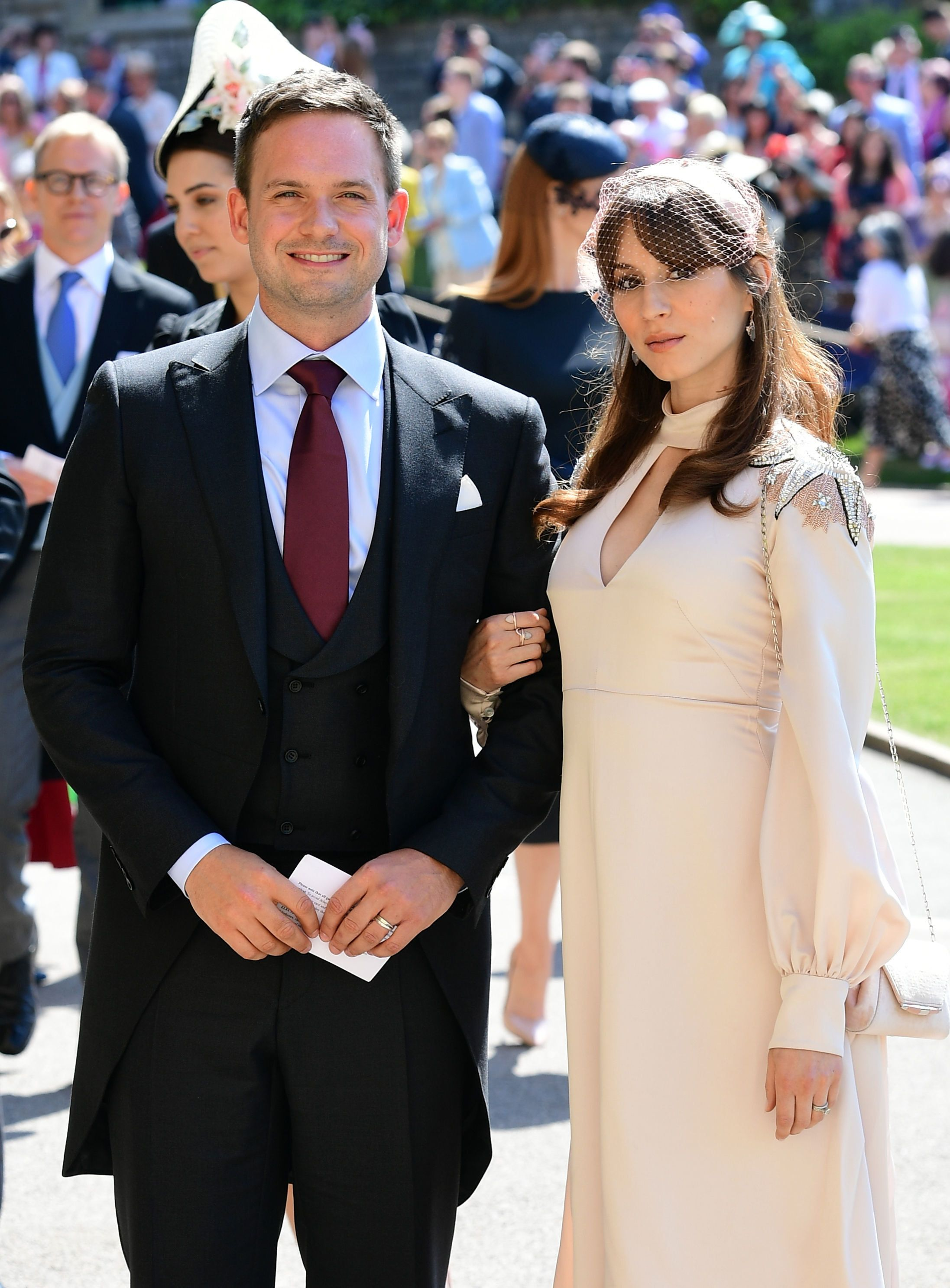 Meghan Markle's friend, US actor Patrick J. Adams and wife Troian Bellisario arrive for the wedding ceremony of Britain's Prince Harry, Duke of Sussex and US actress Meghan Markle at St George's Chapel, Windsor Castle, in Windsor, on May 19, 2018. (Photo by Ian WEST / POOL / AFP)        (Photo credit should read IAN WEST/AFP/Getty Images)
