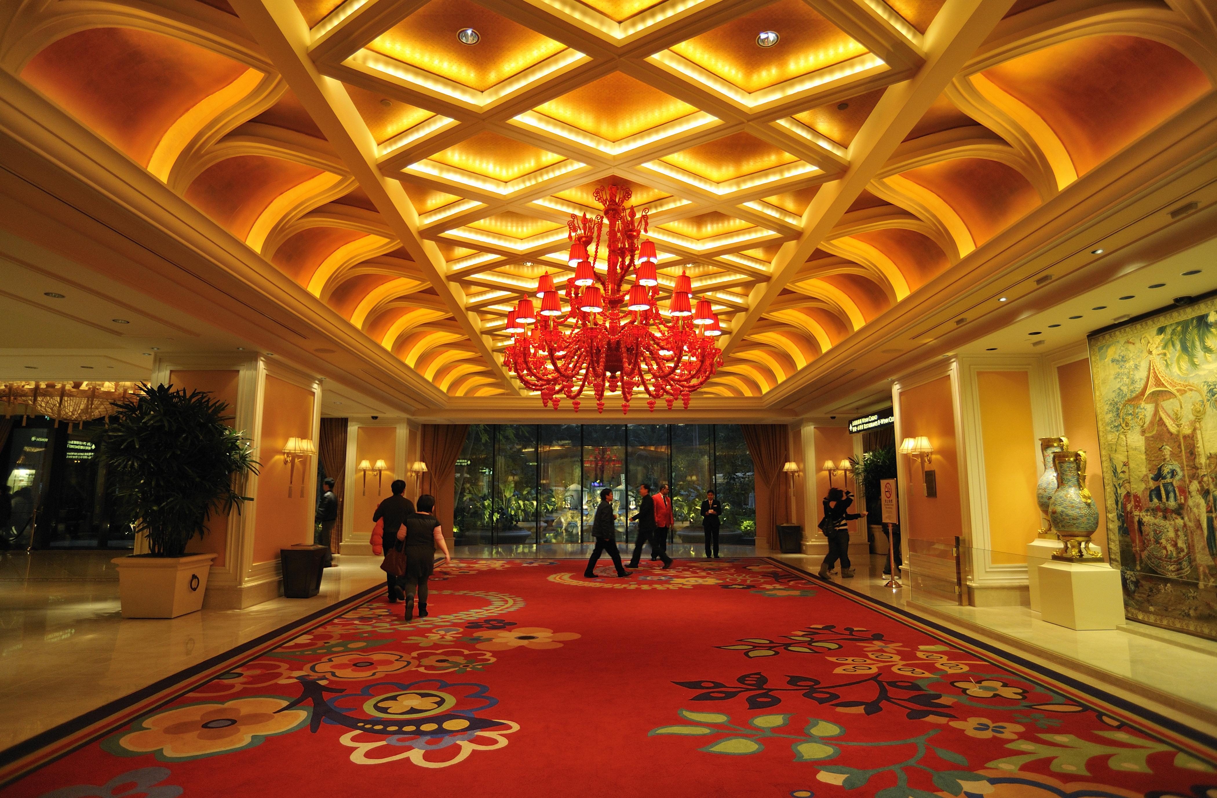 "Bernard books a penthouse suite at the sumptuous <a href=""https://www.wynnmacau.com/en"" target=""_blank"">Wynn Macau</a> for Co"