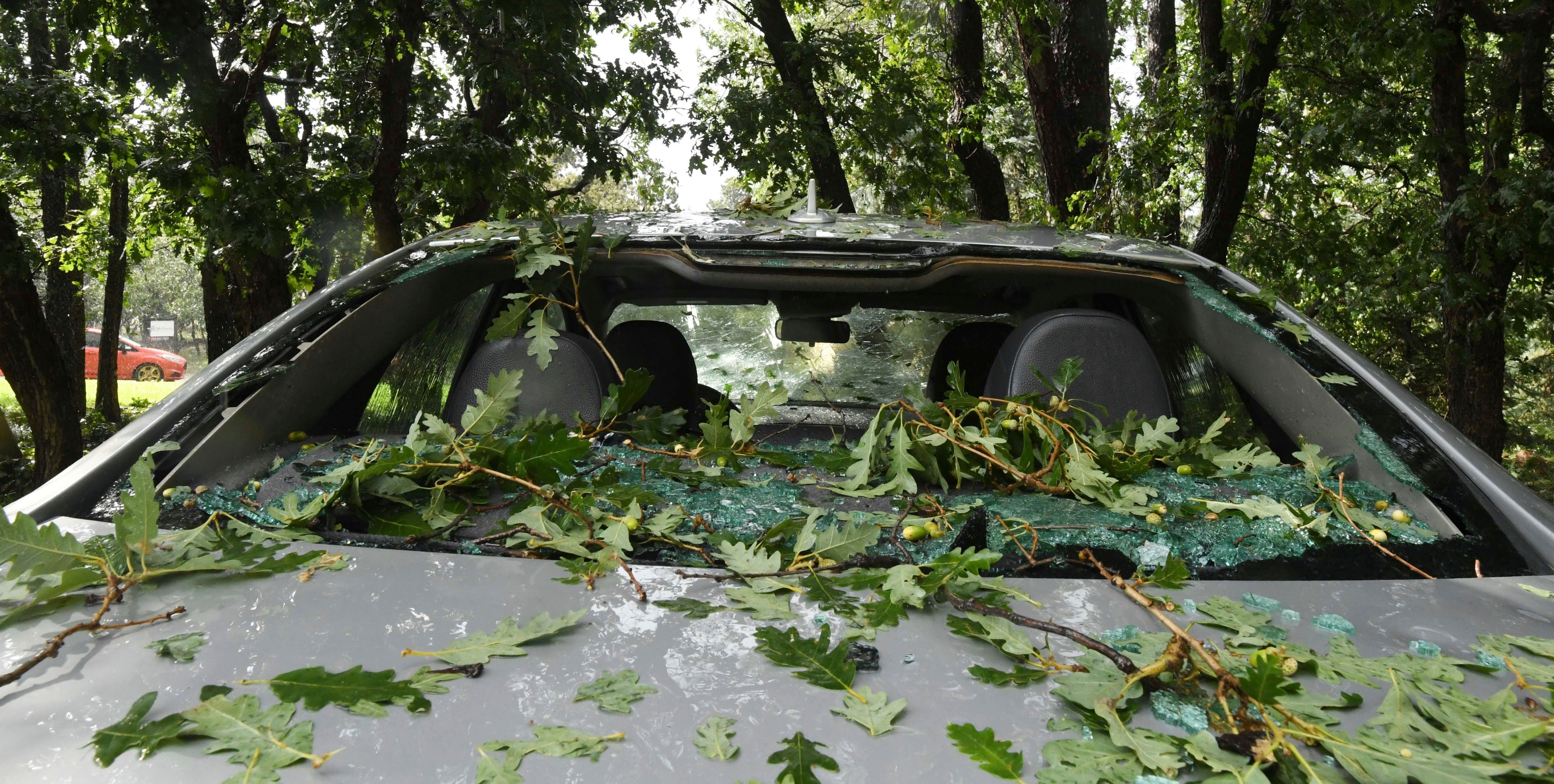 The back window of a car is broken in the Broadmoor area of Colorado Springs Colo after a hailstorm with stones the size of baseballs hit the area Monday Aug 6 2018 Jerilee Bennett/The Gazette via AP