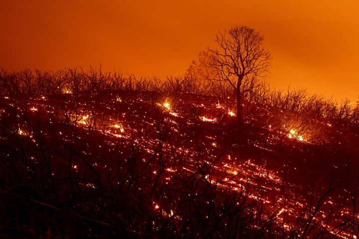 Embers smolder along a hillside after the Ranch Fire, part of the Mendocino Complex Fire, which burned though the area near C
