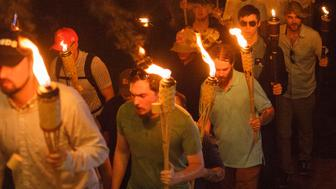 Neo Nazis, Alt-Right, and White Supremacists take part a the night before the 'Unite the Right' rally in Charlottesville, VA, white supremacists march with tiki torchs through the University of Virginia campus. (Photo by Shay Horse/NurPhoto via Getty Images)
